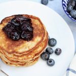 banana and peanut butter pancakes with blueberry compote